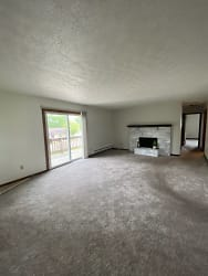Living room with slider going out to 30 foot balcony.