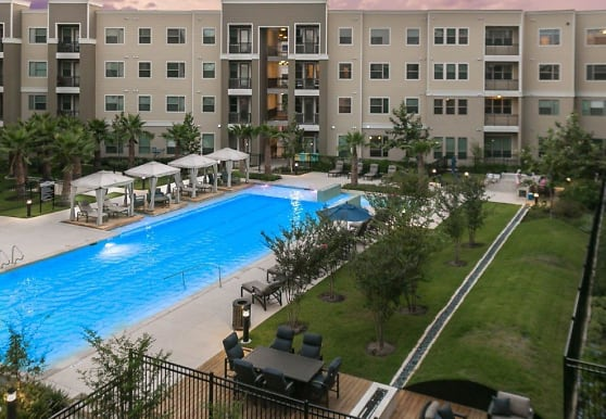 view of swimming pool with a lawn, District at Medical Center
