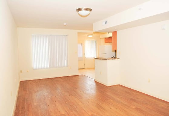 spare room with parquet floors and refrigerator, The Larkspur