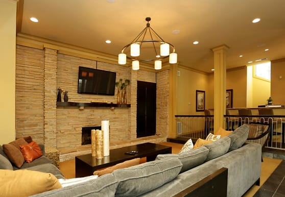 tiled living room featuring a fireplace and TV, Peppertree Apartments