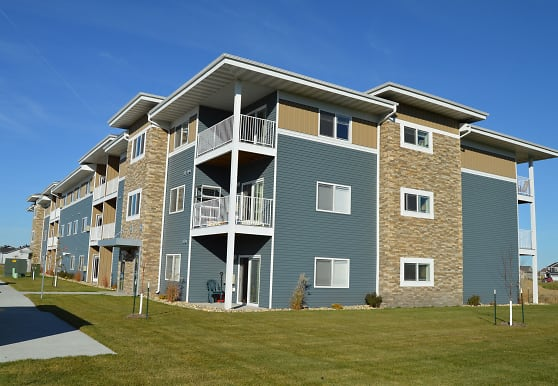 view of building exterior with a lawn, Griffin Court Apartment Community