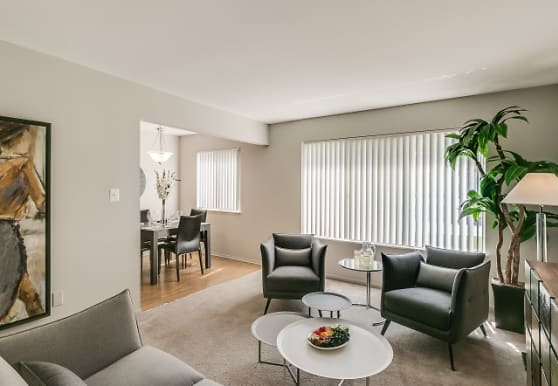 living room with hardwood floors and natural light, Bloomfield Square Apartments