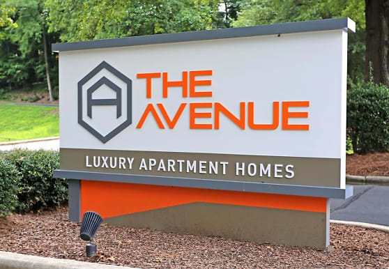 view of community sign, The Avenue Apartments