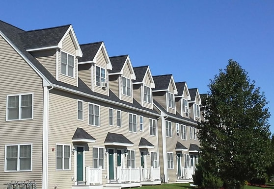 view of front facade featuring a front yard, Legacy Park Apartments
