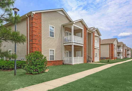 back of house featuring a large lawn, Park At Lemoyne Apartments