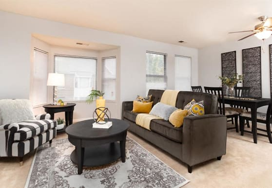 living room with a ceiling fan and carpet, City Side